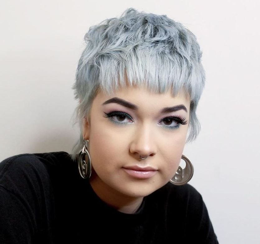 <p>This micro-mullet is so beautifully offset by this steel-blue haircolor.</p>  <p>&nbsp;</p>