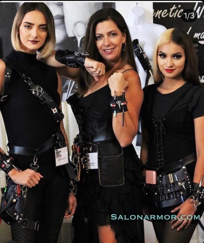 <p>Sandra Teal (center) shows off the power of Salon Armor.</p>  <p>&quot;For years, we snagged our shirts, brought clips home with us, hit clients in the head with swinging clips on our loose sleeves and would be frustrated when we wore something that didn&rsquo;t have a place to put our clips.&quot;--Sandra Teal</p>