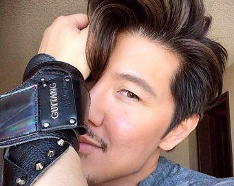 <p>Guy Tang wears a custom-designed piece by Salon Armor</p>