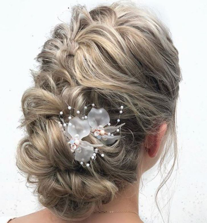 <p>A detailed updo by Sarah Malinda @beautymarkedbysarah.</p>