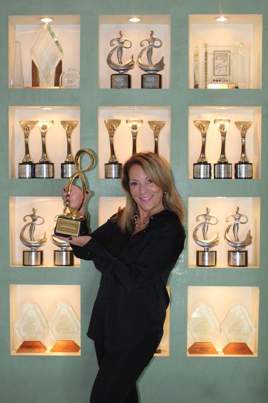 <p><strong><em>Joni Rae with her Mobius Award, an international competition that recognizes outstanding advertising, design and creativity.</em></strong></p>