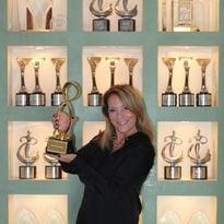 Joni Rae with her Mobius Award, an international competition that recognizes outstanding...