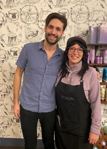 <p>DiGrazia poses for a picture with her client and his new hair cut.</p>