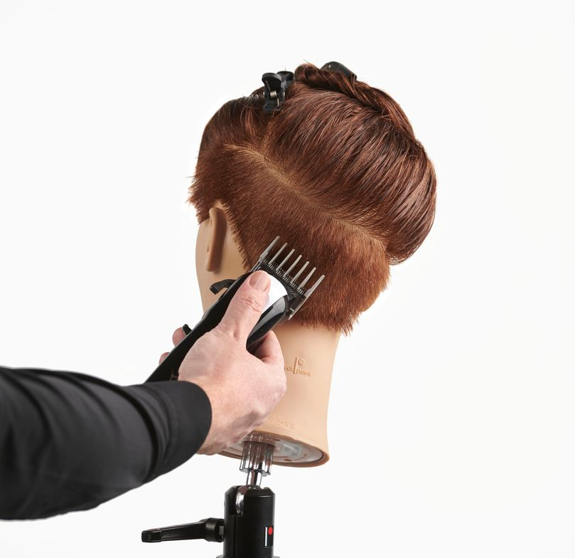 <p>This pixie cut by Great Clips, Inc. National Education Services Specialist <strong>Scott Sellers</strong> has one clippered side and one non-clippered side, with the clippered side on the same side as the natural part. Sellers separated the top from the sides and back with a &ldquo;swooping&rdquo; parting from the temple to behind the opposite ear, then created a skip fade below the parting. The top is elevated&nbsp; and over-directed to the natural part, using varying razor techniques.</p>