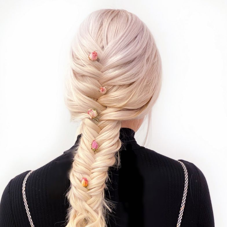 <p>This season, clients are loving all types of adornment. Consider placing tiny rosebuds in a romantic French fishtail braid for bridal and prom clients. Hair: @jamiewileyhair</p>