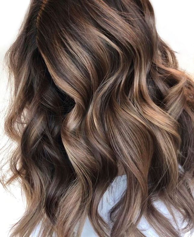 <p>The queen of amazing brunette highlights, <strong>@hairbyamybee</strong>, completed this balayage with <strong>Total Results Brass Off Shampoo</strong> to combat brassy tones. To style, she curled the hair with a 1&frac14;-inch iron, let the curls set/cool and brushed through.</p>