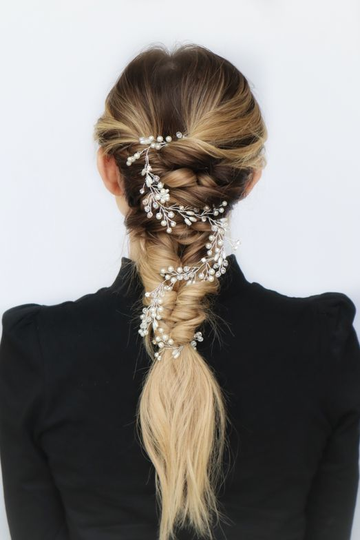 <p>This Boho look combines a textured, pull-through braid with a pancaked, fishtail braid. &ldquo;It&rsquo;s a great way to show off balayage color,&rdquo;&nbsp; Alders says. Threads of pearly beads accessorize the look. Hair: @emily.alders</p>