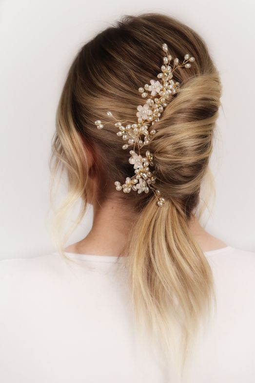 <p>The Italian twist&mdash;with hair emerging from the bottom rather than the top&mdash;is the bridal version of the messy bun. &ldquo;Leave some soft tendrils to frame the face,&rdquo; advises Alders. Hair: @emily.alders</p>