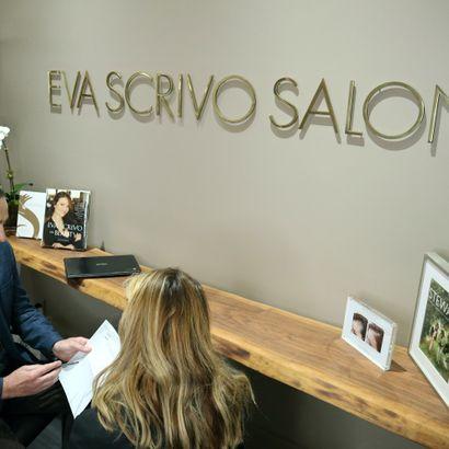 Arik Efrosof the Eva Scrivo Salonexplaining the benefits of their 401K program to a potential...