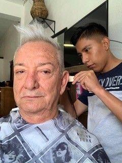 <p>Getting his hair cut in Mexico</p>