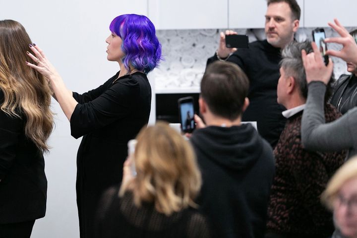 Sydney Ann Lopez (@sydneyannlopezhair) demonstrates proper posing for KMS artists at the KAO Academy in Toronto.
