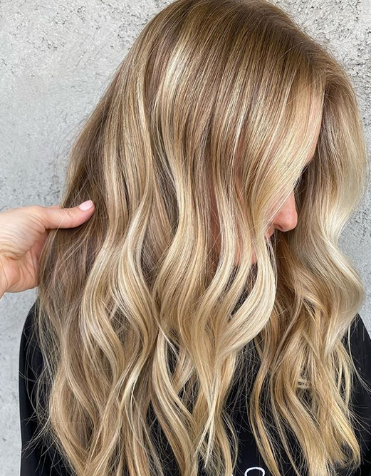 <p><strong>Haircolor looks freshest with a subtle finish that reflects highs and lows. Carly Zanoni, @the.blonde.chronicles, achieved this design with: IGORA VARIO BLOND Plus Lightener + 20-volume (teasy lights); IGORA VIBRANCE 8-0 + 7-65 + 6-volume developer (lowlights applied to large sections on dry hair); IGORA VIBRANCE 8-0 + 7-65 + 7-1 + 6-volume developer (root melt) and new tbh&mdash;true beautiful honest 9-49 + 10-19 + 10-51 + tbh&mdash;true beautiful honest Tone Softener + 6-volume IGORA VIBRANCE Activator Lotion 13-volume developer (mids and ends)&mdash;all Schwarzkopf Professional. </strong></p>