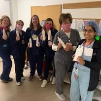 Grateful nurses and front-line hospital workers with gifted Innersense Organics hair care, a...