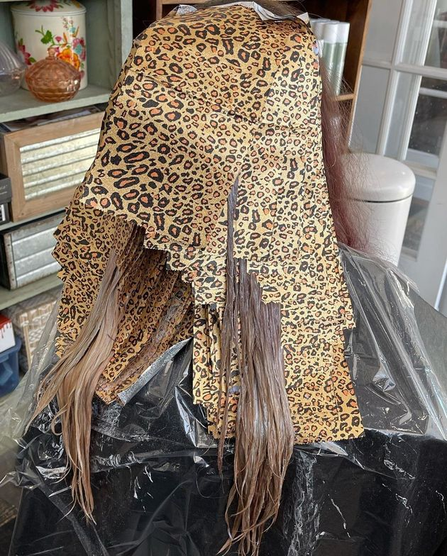 <p><em><strong>In process (and those leopard print papers...)</strong></em></p>