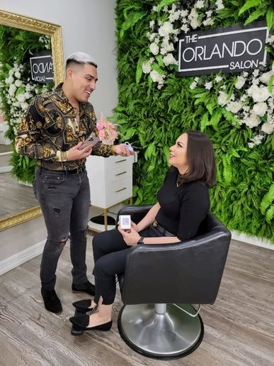 """The Orlando Salon's Orlando Rodriguez tested the new Hair AI app – the latest innovation from John Paul Mitchell Systems® - on his client Astrid Mahoney, and they call the tool """"life-changing.""""   -"""