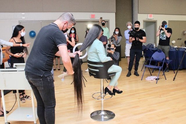 """<p><a href=""""https://www.haircuttery.com/"""">Hair Cuttery</a> Stylist Gregory White at work.</p>"""