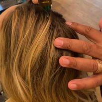 Chuck Hezekiah applies a scalp treatment