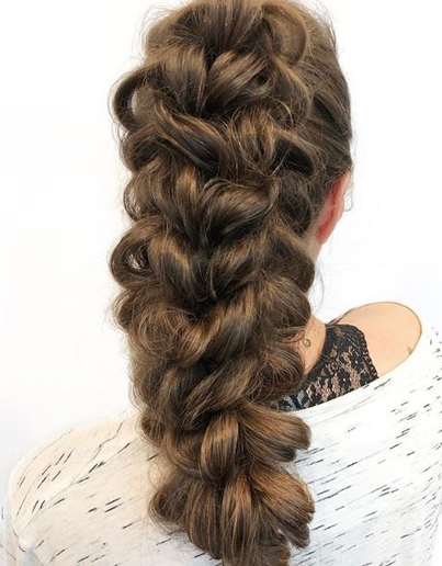 Valsamis used GL Tapes from Great Lengths to give this braid depth and thickness.