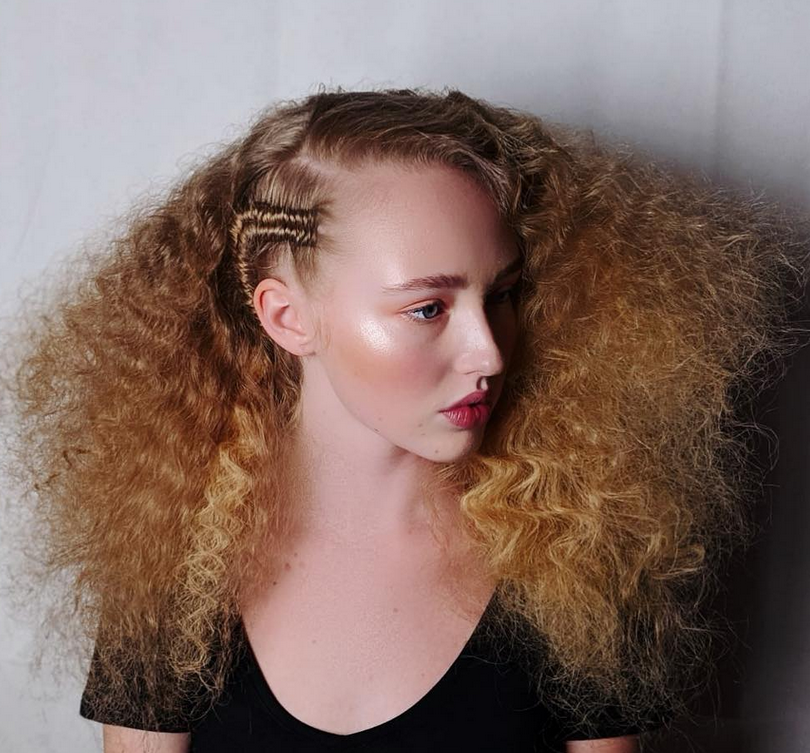 <p><strong>amika and SalonCentric #ittakesapro team member Naeemah LaFond, @naeemahlafond used amika&rsquo;s Haute Mess Texture Gloss,&nbsp;Bushwick Beach No-Salt Wave Spray, Vandal Volumizing Powder Spray and Heist Molding Blend to create rick-rack texture embellished by tiny, figure-eight braids. Naeemah created the texture by setting 1-inch sections on a large, u-shaped metal wire, and then brushing out the set with a detangling brush.</strong></p>