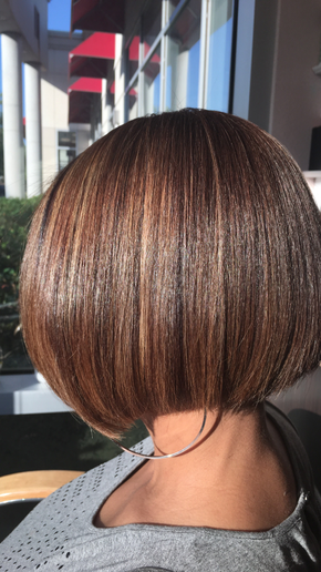 Bronde hair color is in high demand among clients with darker, curly hair, and the last thing they want to see is warmth. To achieve this neutral bronde on Level 3, flat ironed, natural hair, Jeannetta Walker's favorite strategy is to first lift the level 3 natural base with Alfaparf Evolution of the Color  6.1 + 6 pumps of Ah Pigments + 40-volume developer. Process for 35 minutes, shampoo and place the client under a hooded dryer. Then she applied balayage highlights with AlfaParf BB Bleach + 20-volume developer, lifted the hair to Level 9 and toned with Color Wear 9.13 + 5-volume activator.  -