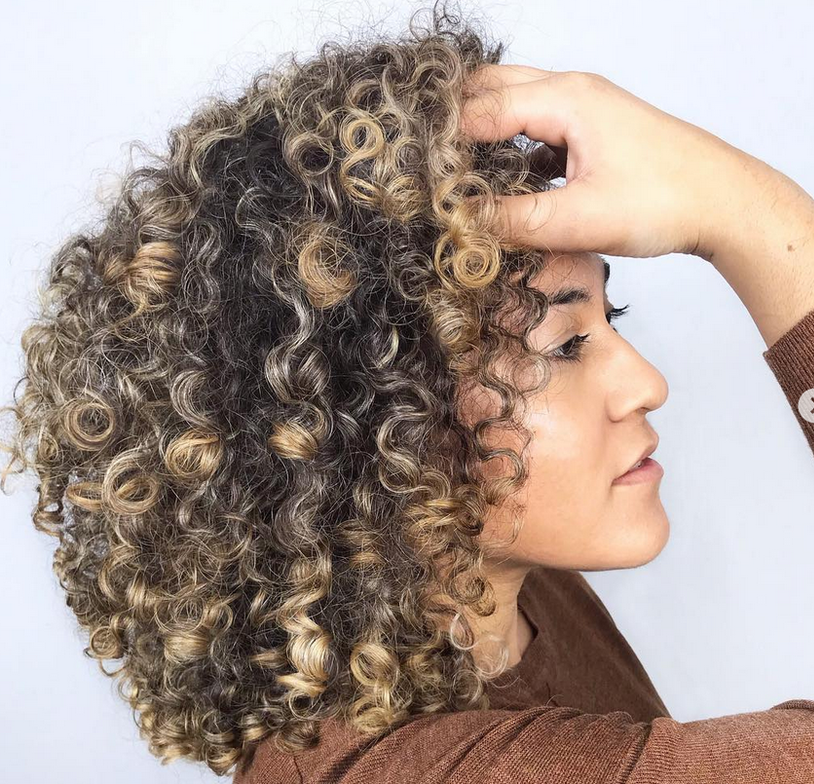 <p><strong>Forget the comb when you&rsquo;re cutting curls, says DevaCurl Academy Technical Training Manager Cal Ellis. Instead, use your fingers to section the hair. @devacurlpro</strong></p>