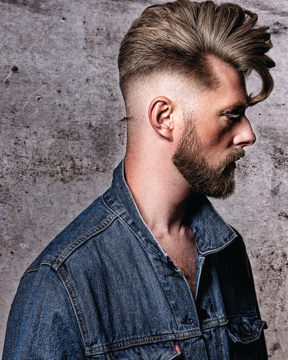 <p>Maximum Movement: ANDREW</p>  <p>With lots of movement, Bustos was inspired by the flow of water for this look. He began with a skin-tight short blend with a heavier weight line following the model&rsquo;s head shape. The weight line starts from the brow bone, arching up and around the ear, and drops to the top of the occipital bone.The top length was cut with texture to help support the length. Thes horter lengths in the interior act as a support system to lift up the longer lengths with minimal product to ultimately create a natural waterfall-like flow in the style.</p>