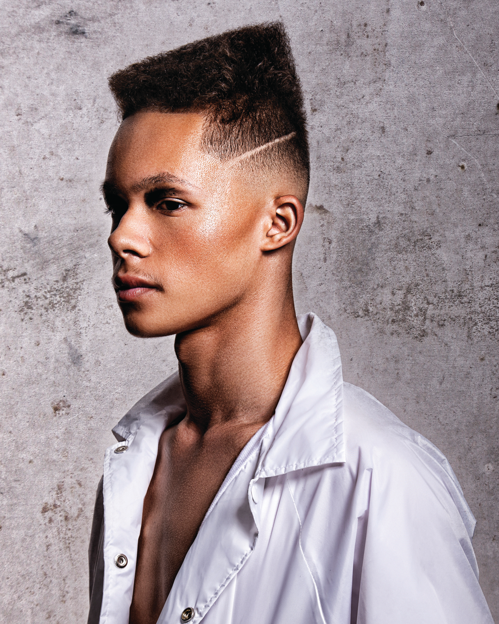 <p>Zero Movement: PALACE</p>  <p>Taking inspiration from Grace Jones, Bustos began with a skin-tight blend stretched to create a seamless transition into the top lengths.&ldquo;The shape and flow of this hair cut starts from the collarbone acting as the foundation,&rdquo; Bustos explains. &ldquo;Follow the sternocleidomastoid muscle up the neck and around the occipital bone to create a soft arch that aggressively shifts into a sharp corner, dropping gradually in length toward the front hairline.&rdquo;The trajectory of the angle of the way the hair was cut on top stays parallel and consistent with the model&rsquo;s cheekbones, jawline, and down to the collarbone. An accent parting was carved onto the side starting at the temple, also staying consistent with the angles of the model&rsquo;s strong features.</p>