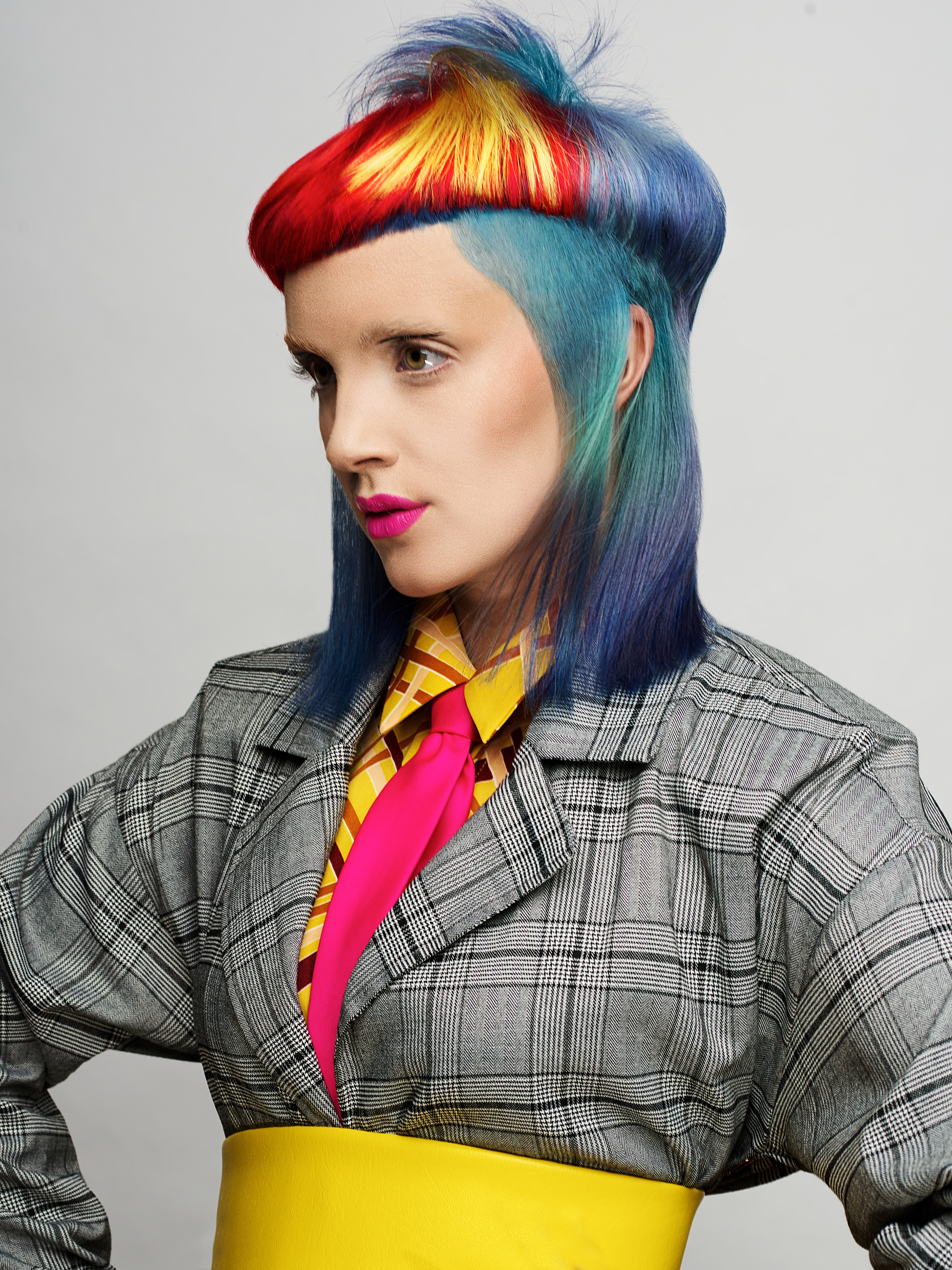 <p>Kylie Bussing</p>  <p>The Hair Company&nbsp;</p>  <p>Nashua, New Hampshire</p>  <p>Kylie Bussing is known for bushing boundaries. So when it came to finding a model for her Color Zoom entry, she knew she had her work cut out for her: She not only needed a model, she needed a model who was willing to wear an alternative look for months. &ldquo;I have gotten so many questions about how my model maintained this look in between the intial photoshoot and the time it took to hear back if we were going to be competing live,&rdquo; Bussing says. &ldquo;This collection was all about pops of color and pure tones, so as I designed this look I knew I would have to do it in a way where I could also take the color out for a look she was willing to wear in between competitions.&rdquo;&nbsp;</p>