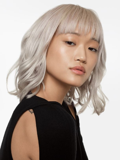 This no-filter platinum blonde by Redken Celebrity Colorist Tracey Cunningham owes its cool perfection to the new Shades EQ Gloss 010VV.  -