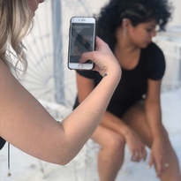 Hailey Mahone grabs a shot of her model behind the scenes