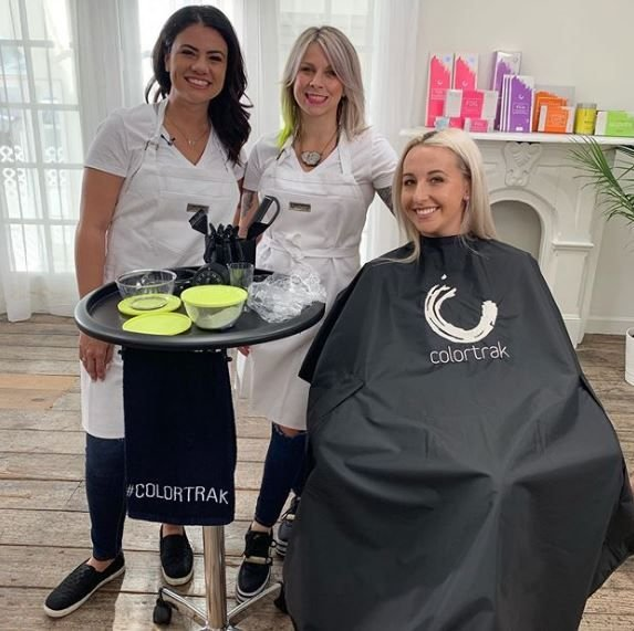 <p>Colotrak Ambassadors Kate and Gabby pose with their model after filming.</p>