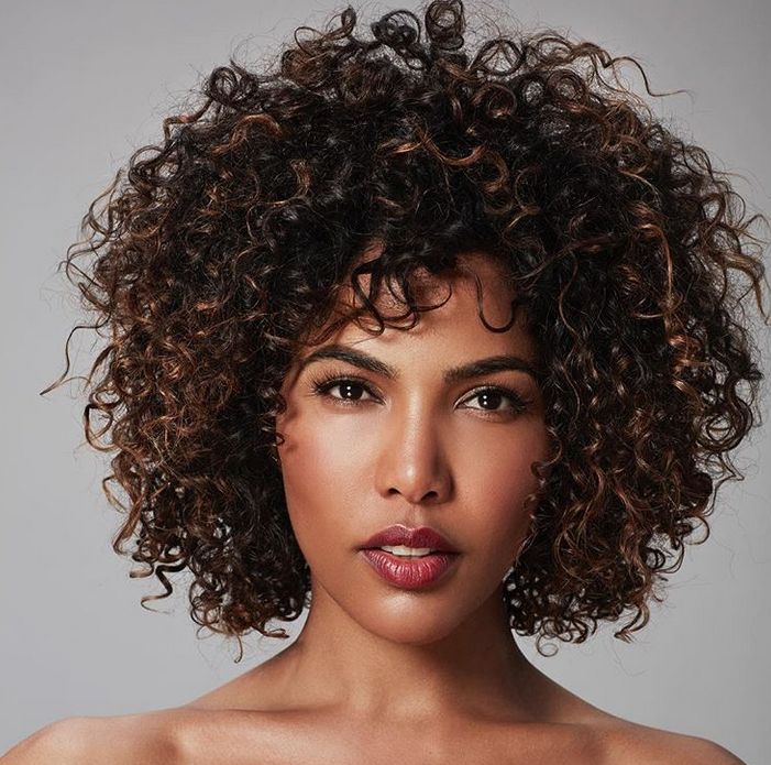 <p><strong>Tommy&rsquo;s curly girl comes alive with an application of Aloxxi Andiamo Express Permanent Color 4N on base, followed by Aloxxi Freehand Lightener + 30-volume developer to &ldquo;pop the corkscrews.&rdquo; To neutralized warmth.&nbsp; To enhance a client&rsquo;s look tone with</strong> <strong>InstaBoost </strong><strong>Hazel-Nuts For You. &ldquo;I would send her home with the InstaBoost,&rdquo; he says, &ldquo;to control unwanted warmth without over-neutralizing the cool tones.&rdquo; @tommycolehair</strong></p>