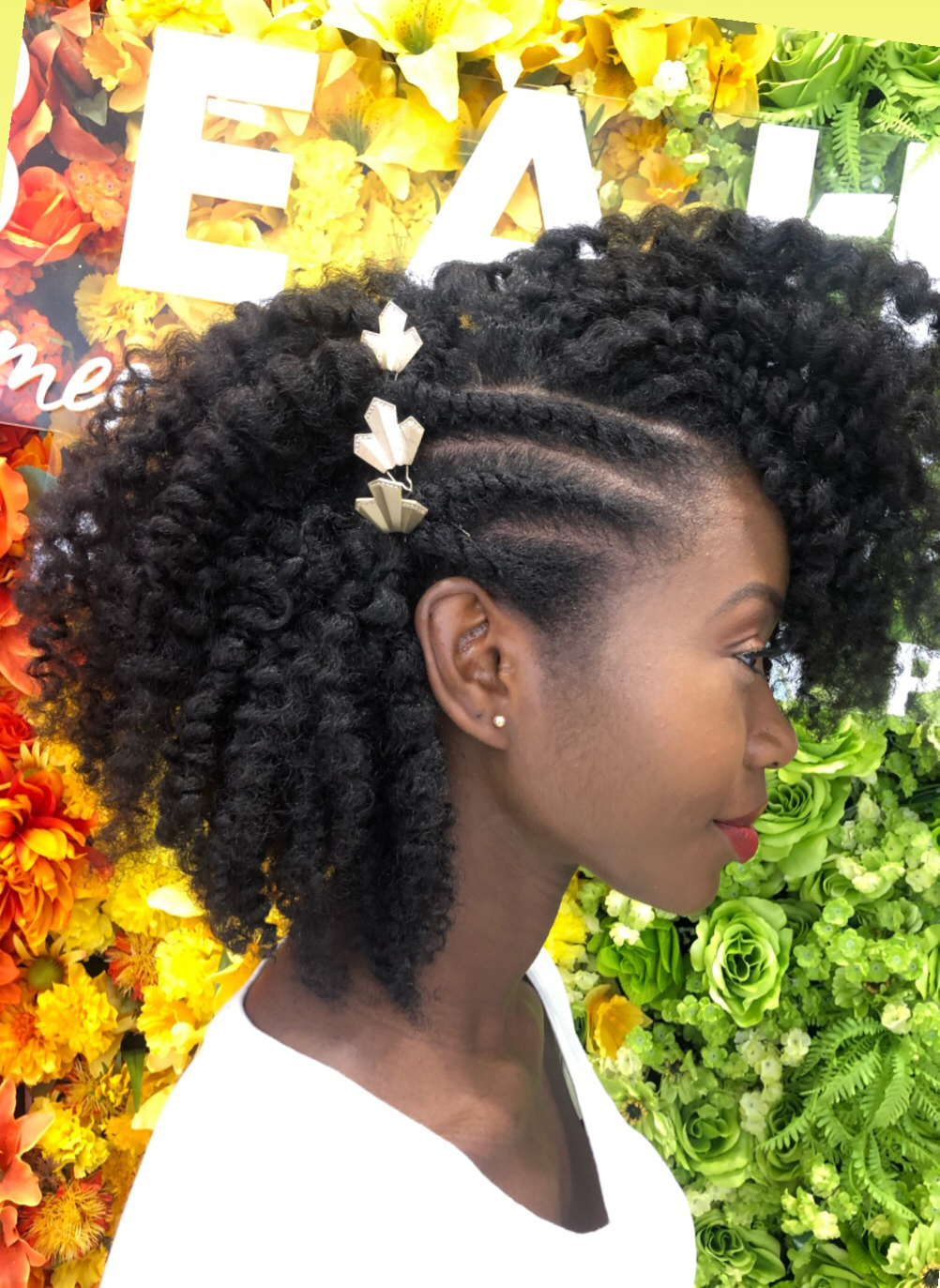 <p><strong>Pekela&rsquo;s finished look includes a few twists left intact and adorned with gold leaves.</strong></p>
