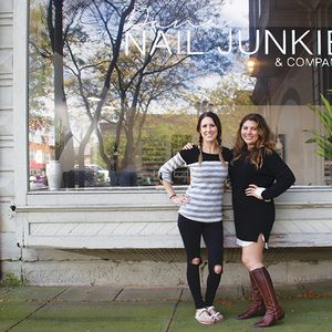 That's me (on the right) with salon owner and nail artist Dana Cecil. This building had many...