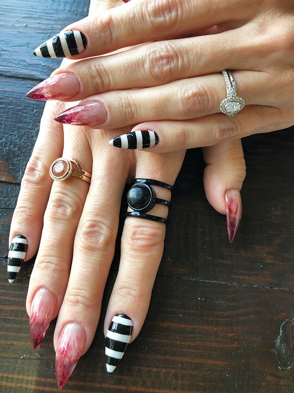 <p>We visited Nail Junkie before Halloween, hence all the festive nail art. The jewelry shop next door will even clean clients&rsquo; rings while they&rsquo;re getting their nails done.&nbsp;</p>