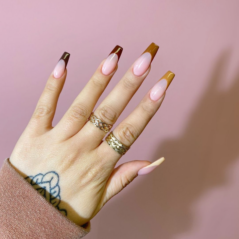 <p>TGB Nail Expert @smnailz wears a French manicure featuring the Nu Nudes Collection (from thumb to pinky) Vanilla, Caramel, Woody, Chocolate, and Mocha.</p>