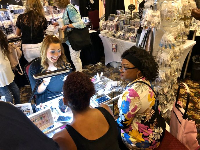 Shop talk at the Venus Beauty Supply booth.  -
