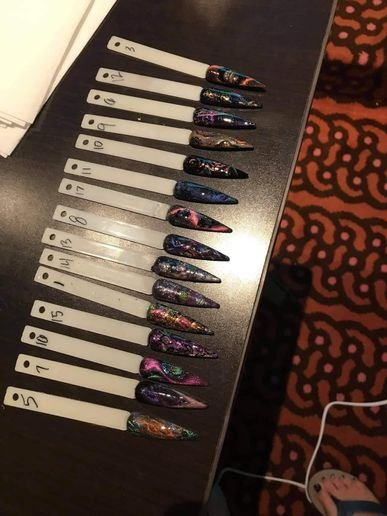 Cat-eye nail competition entries.