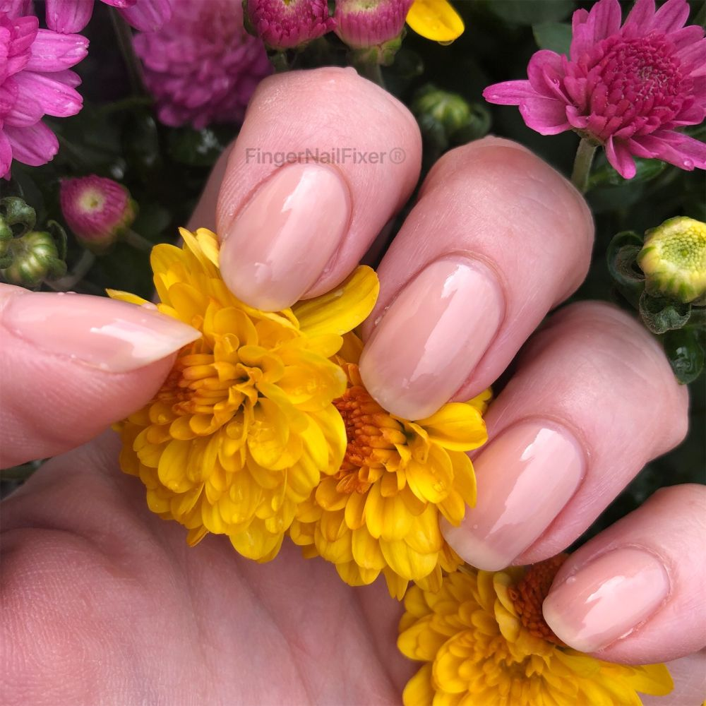 Fall flowers make a great background for nail photos. 