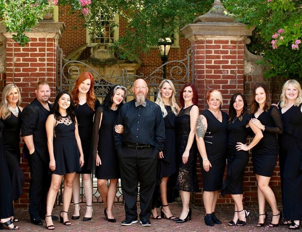 <p><strong>Tips have gotten bigger for the team at Sage Tryall Salon, and life has gotten easier for owner Suzy Tryall (fifth from left).</strong></p>