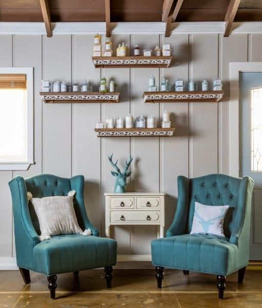 <p>Armchairs in a soothing shade of blue encourage clients to begin their journey of relaxation at The Beauty Artisan &amp; Co. in Murrieta, California.</p>