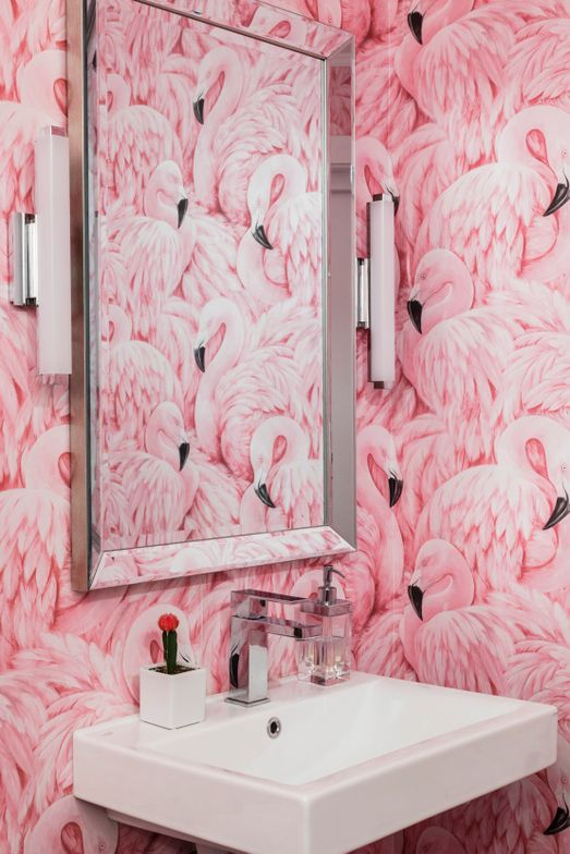 <p>In the mostly white Lindsay Griffin + Co in Somerville, Massachusetts, the hot pink flamingo wallpaper in the bathroom serves as a lively surprise.&nbsp;</p>