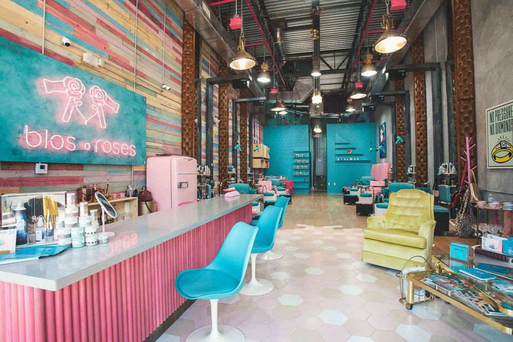<p>A retro bar and neon signage in Barbie pink makes a bold statement against the pastel-colored shiplap through Blos Roses in Doral, Florida.&nbsp;</p>