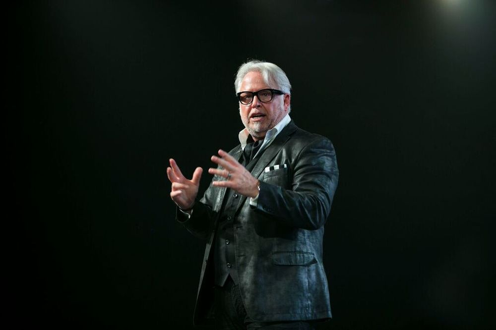 <p>Frank Gambuzza on stage at Intercoiffure.&nbsp;</p>