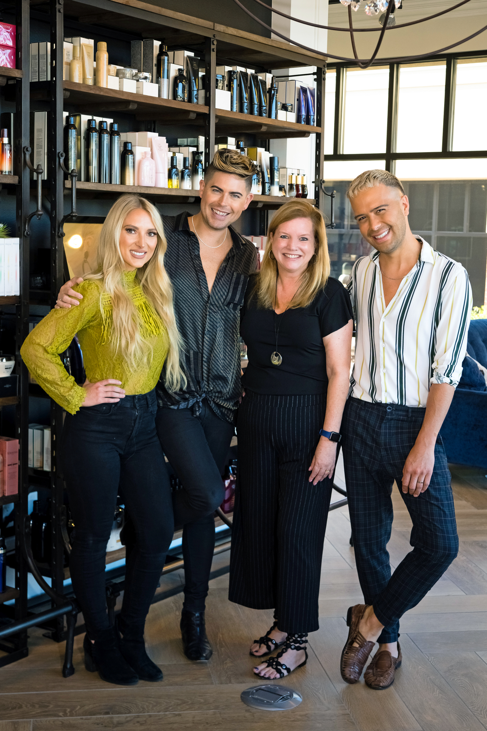 <p>Taylor Miller, Cameron Kepford and Ramiro Corrales, owners of Haus of Heir in Davenport, Iowa, with Stacey Soble at&nbsp;the photoshoot with photographer Karen Bishop.&nbsp;</p>