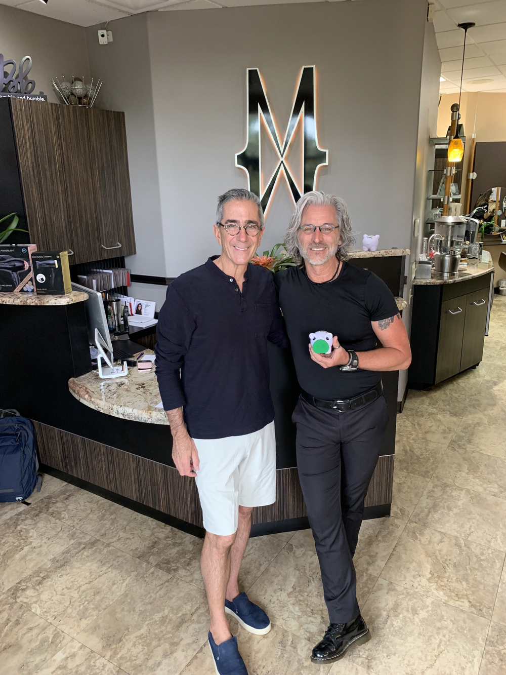 <p>David Tashjian and Mitch Eubanks&nbsp;at the front desk of the Mitchell Wade Hair Salon in Oviedo, Florida.&nbsp;</p>