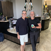 David Tashjian and Mitch Eubanks at the front desk of the Mitchell Wade Hair Salon in Oviedo,...
