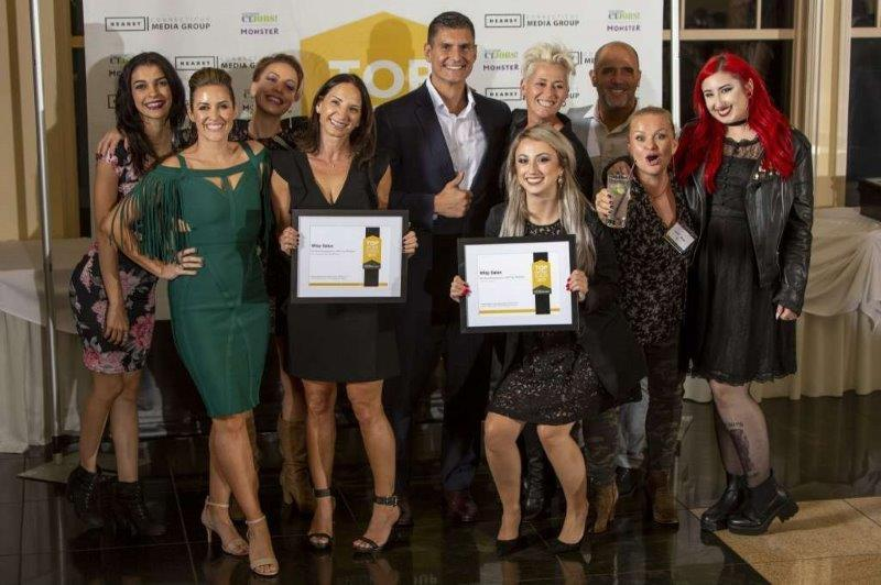 <p>The team from Whip Salon accepting their Top Workplaces 2019 awards.</p>