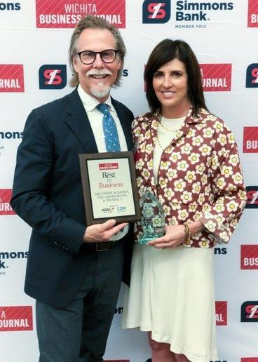 Eric and Mary Fisher accept the Best in Business Award for the Eric Fisher Salon in Wichita, KS. 