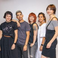 The team from Let 'Em Have It Salon in Denver, CO.